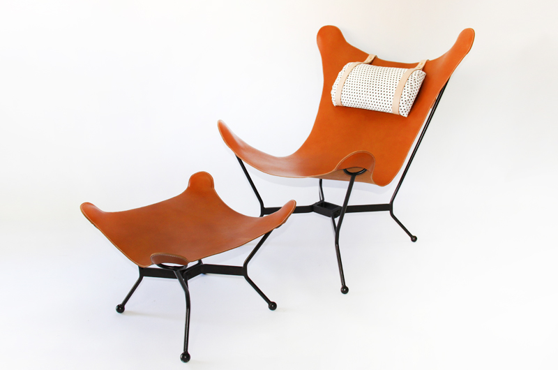 unusual pair of butterfly leather sling chairs with matching ottomans cast iron frames with ball foot saddle leather slings with black dot